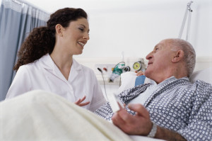 Nurse Caring for Elderly Patient --- Image by © Royalty-Free/Corbis